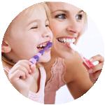 Mother & child Enjoying Brushing Their Teeth
